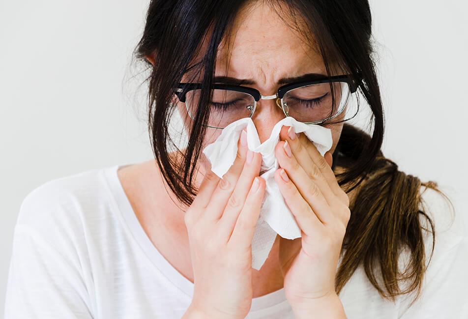 image d'une femme ayant la grippe